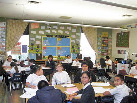 Fourth graders at Uplift Education's Peak Preparatory School work at their desks.