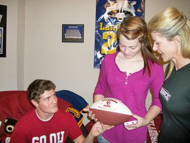 Lambring reminisces with her son, Briggs, and daughter, Alexandra, about their memories of Texas-OU football.