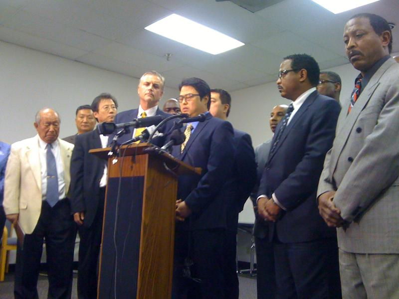 Store owner Thomas Pak stood with leaders in the Black and Korean communities as he apologized for the ongoing conflict.