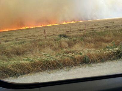 This photo of the fire line was posted on Facebook around 1 p.m.