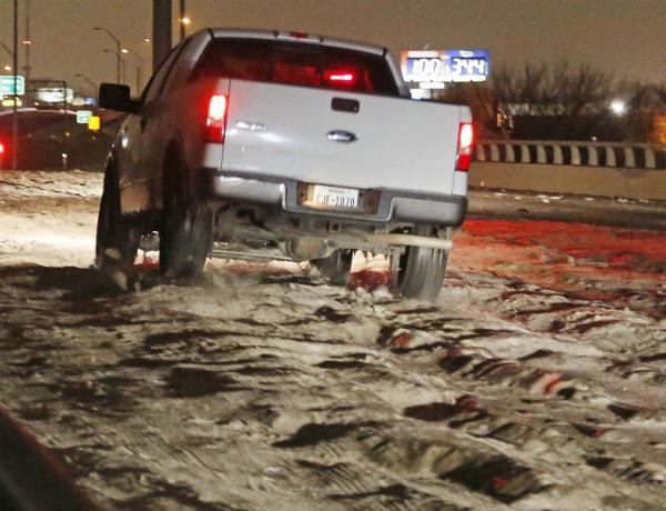 Cobblestone ice has made travel downright dangerous. Over the weekend, Ross Hailey of the Star-Telegram captured this truck driving over cobblestone ice in Haltom City.