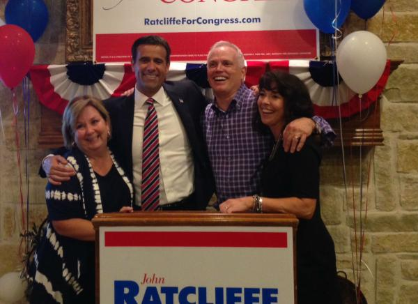 John Ratcliffe, second from left, celebrated victory Tuesday night with neighbors. Ratcliffe, a former U.S. attorney, defeated longtime incumbent Ralph Hall in the GOP runoff for District 4 in Congress.