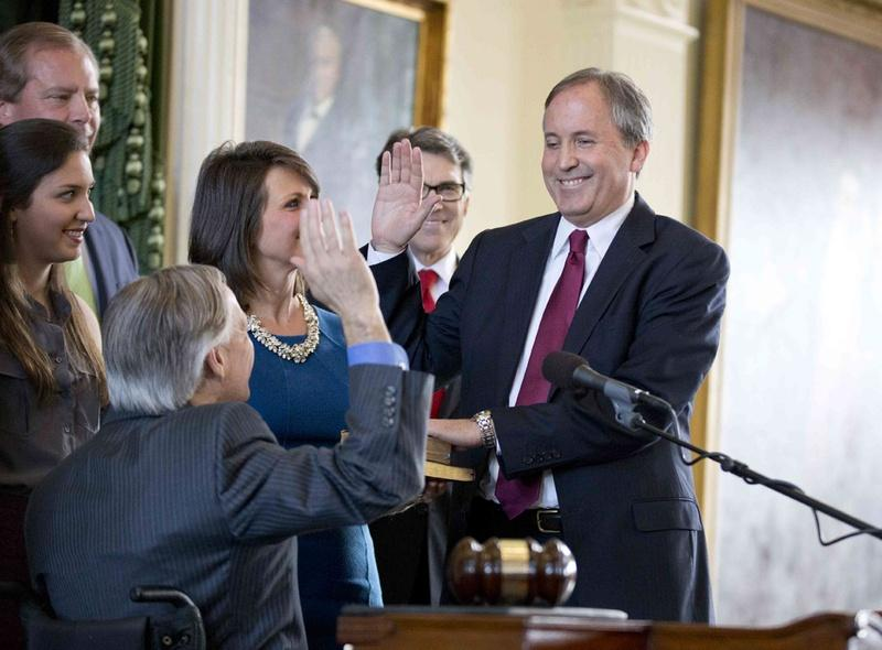 Attorney general ken paxton surrounded by family takes the oath of