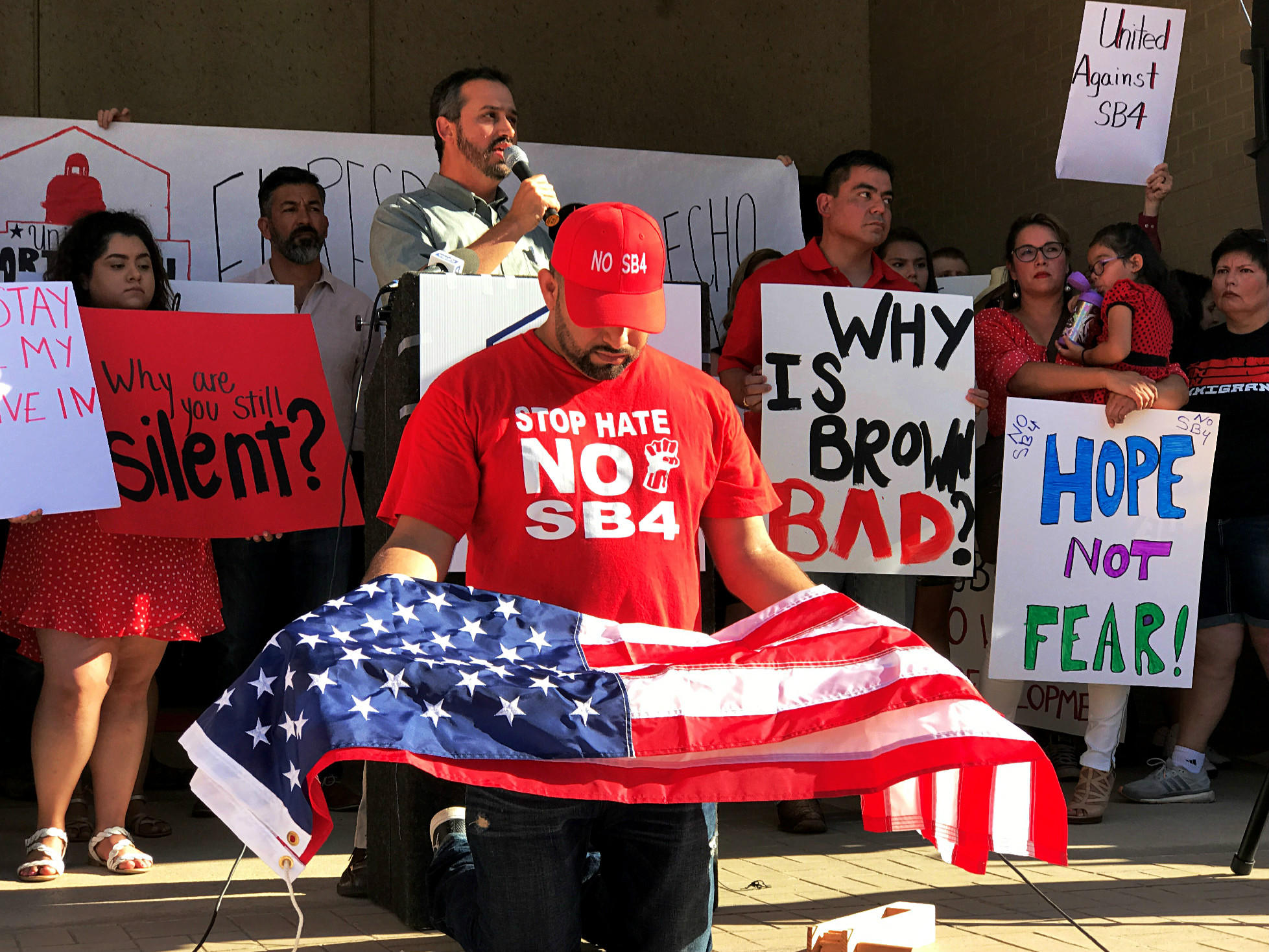 b8c72d9b9d6 TCU professor Max Krochmal addresses demonstrators outside Fort Worth City  Hall at a July 20 rally calling on the city council to join a lawsuit  opposing SB ...