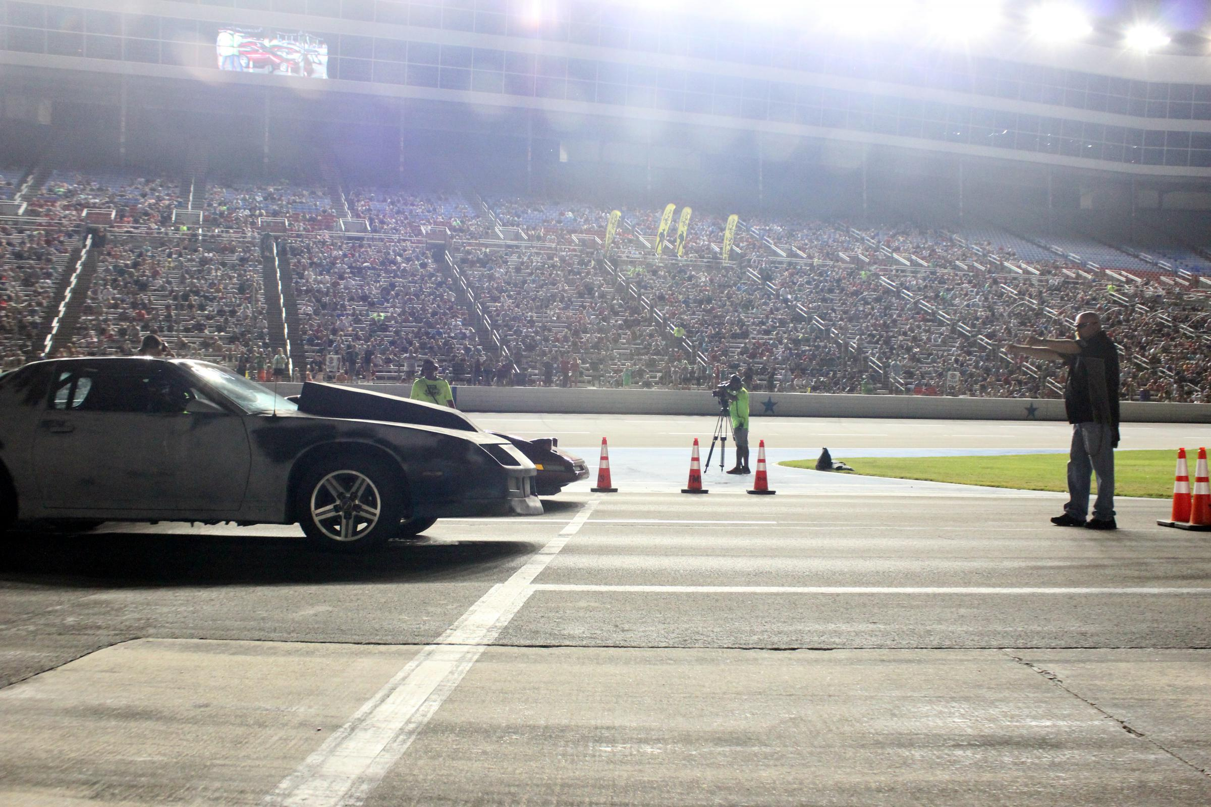 Cars at the start line wait for the signal to speed down the one-eighth-mile drag at the Texas Motor Speedway in Fort Worth, Texas.