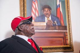 Here, Ivory Moore, Sr. inspects a painting unveiled and on display near the A&M-Commerce President's Office in his honor on September 28th, 2013.