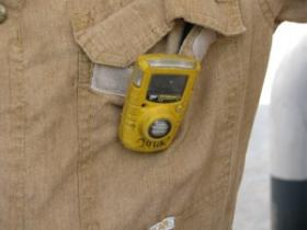 Oil field workers wear these safety alert devices that detect hydrogen sulfide gas.