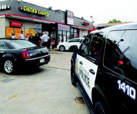 Police respond to a call of a stabbing at the Prime Stop store on Wesley Street.