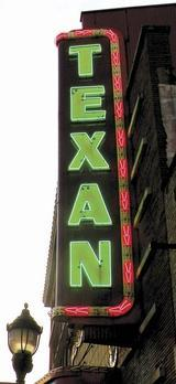 Public hearings are scheduled this week on a plan to add a new electronic sign at the Texan Theater in downtown Greenville.