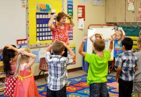 "Ms. Sharon Arthur's kindergarten class starts the first day of school Monday with a song ""Head, shoulders, knees and toes,"" and a dance getting the students ready for a day full of learning at Cooper Elementary School."