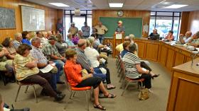 Ben Jasso who owns the Triple J Livestock slaughter plant in Wilmer, Texas addresses the many questions the large crowd for the upcoming establishment in Cooper at Monday's City Council Meeting.