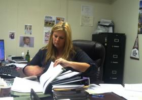 North Hunt Special Utility District General Manager Stacey Nicholson reviews records at her office in Commerce.