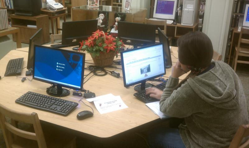 Rachel Vaughn, of Cooper, browses the internet on one of the new computers recently installed at the Commerce Public Library.
