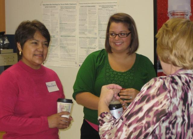 Maria Garza (left), newly hired coordinator of the Commerce Community Plaza, was welcome by A. C. Williams Elementary School staff at a recent reception.