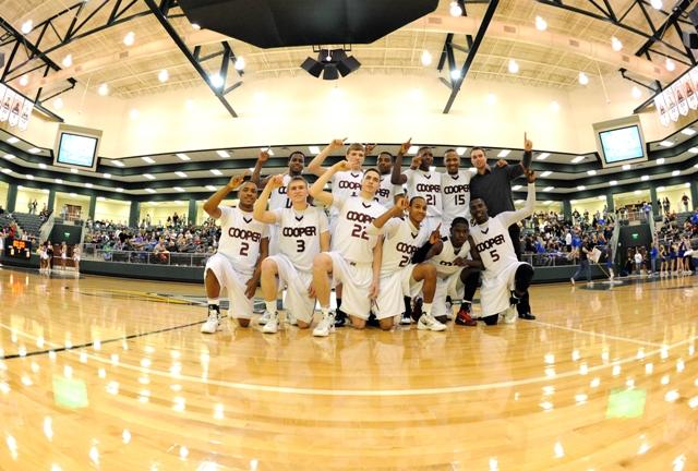 The Bulldog basketball team celebrates their Friday win over Krum, played in Prosper.