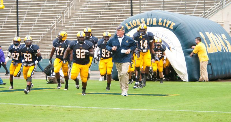 The A&M-Commerce Lions with head coach Guy Morriss.