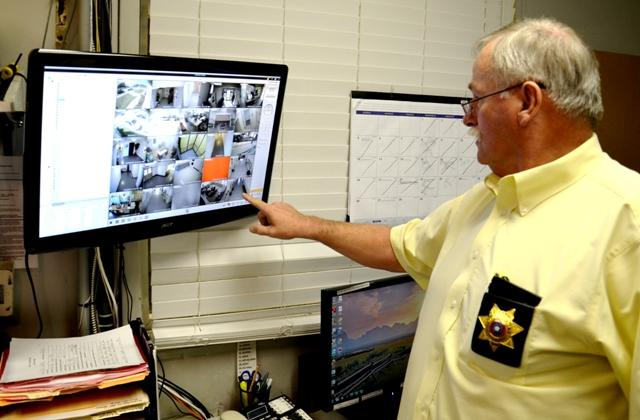 Delta County Sheriff Gerald Teague explains the monitoring hub for the security cameras that are located in the Courthouse and Jail.