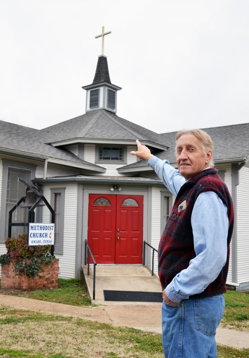 Designer Stephen Russell points to the cross atop Enloe United Methodist Church.