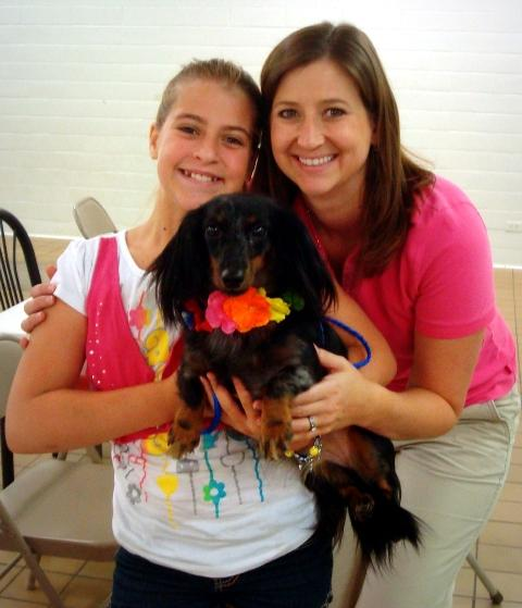 Dr. Hailey, Marissa and Maddie pose as they prepare for the Dog Days of Summer Fun Friday.