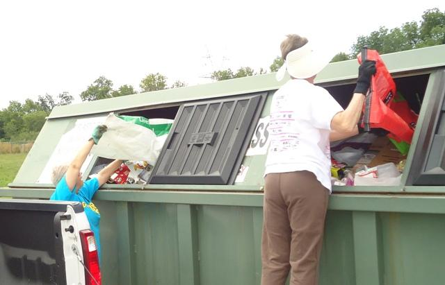 Anne Mills and Laura Milligan help fill the bin Saturday