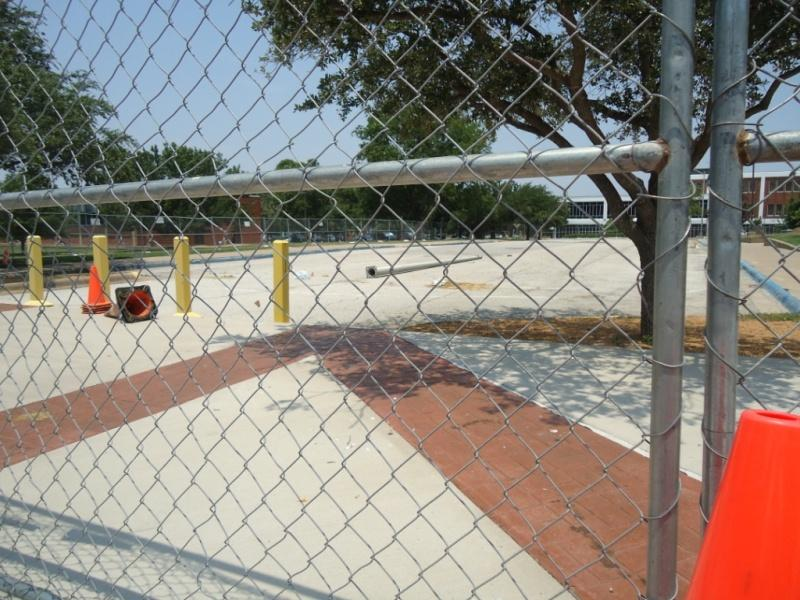 Looking north through the fence where crews will extend the university Walking Mall.