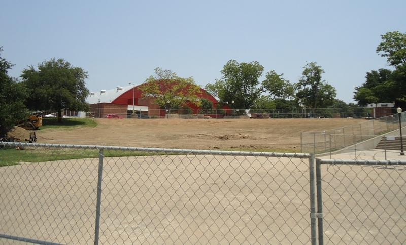 """From inside """"the bowl"""" looking north and the site of the new amphitheater. The Field House in the background."""