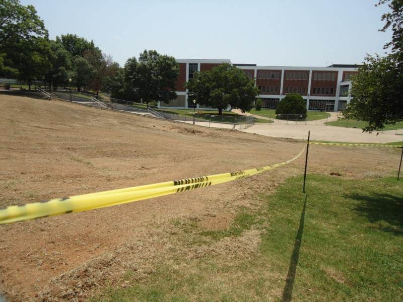 """Looking south out over """"the bowl"""" site of the new amphitheater. Business Administration Building in the background."""