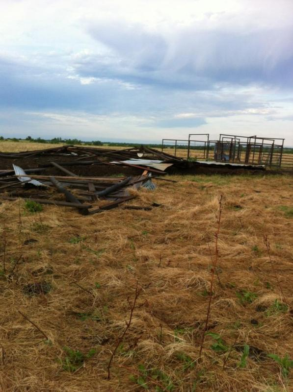 Several barns, located near the intersection of State Highways 24 and 19, were flattened in Delta County due to high winds from last night's storms.