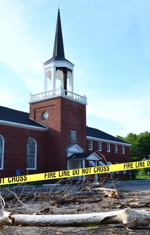 The First Baptist Church in Cooper, located at the corner of SE Fifth Street and West Dallas Avenue, suffered storm damage last night as high winds blew siding from the church's steeple and knocked down surrounding trees.