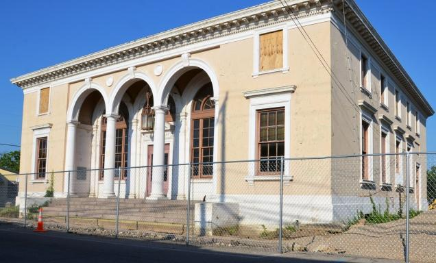 Fencing surrounds the former Sulphur Springs Library on Monday, June 25 during renovation efforts