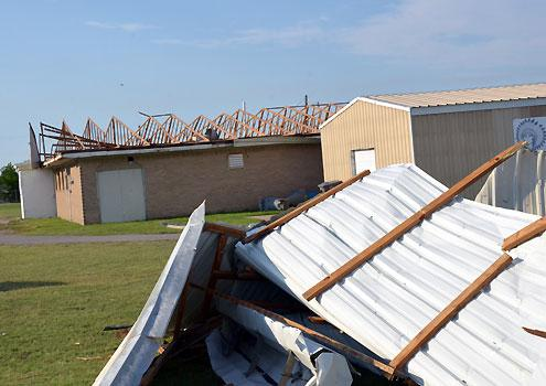 At Warrior Stadium in Bonham, the entire roof of the visitor's field house was blown off by straight-line winds, indicative of numerous damage reports in Fannin and Grayson counties.