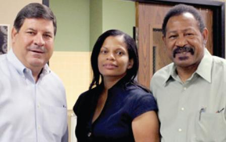 Etta Herring (Center) poses with CISD Superintendent Blake Cooper (L) and Board President Willie Blow (R).