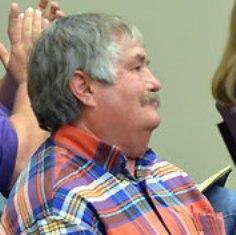 Cpt. Jack Berni receives a round of applause at the April Bonham City Council meeting after announcing his retirement.