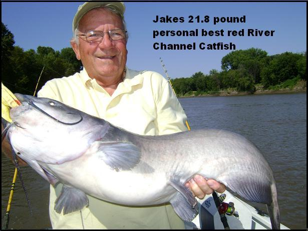 Jake Bussolini proudly displays his personal best Red River Channel Catfish catch.