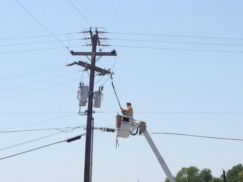 Oncor worker works to remove wire
