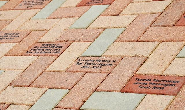 A section of the Memorial with engraved bricks