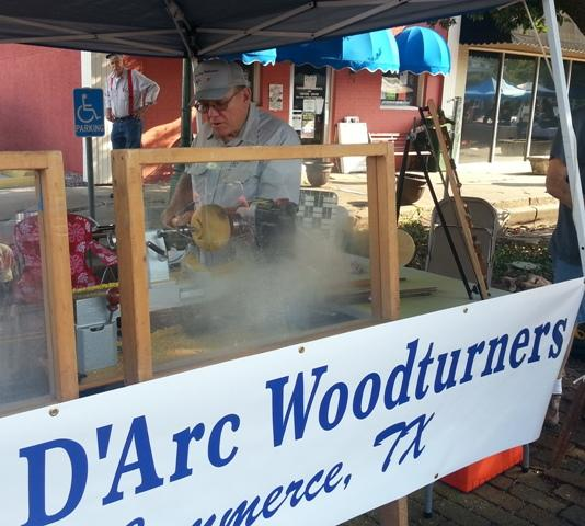 A Bois d' Arc Woodturner carves a piece of Bois d' Arc wood on a lathe