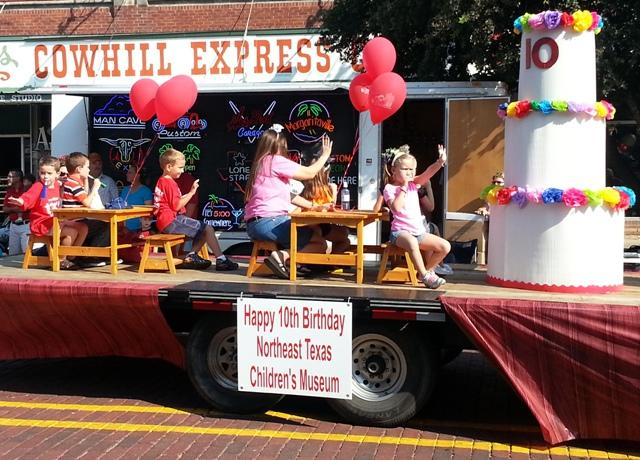 The Northeast Texas Children's Museum celebrates a birthday during the Bash parade