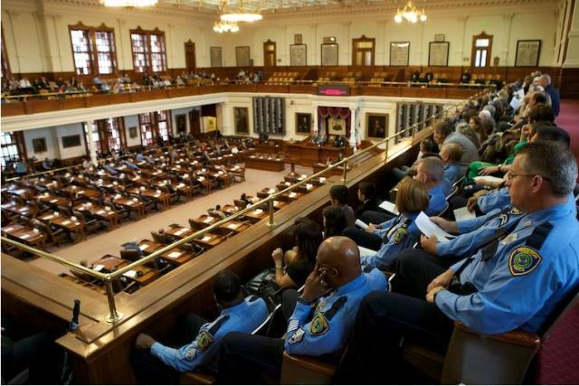 Officers watch Friday's awards ceremony in Austin