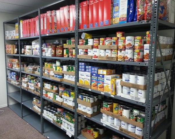 A fully stocked shelf Tuesday at the Commerce Food Pantry