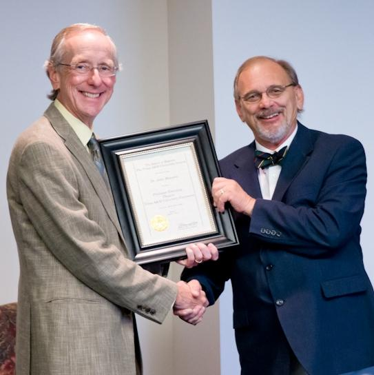 A&M-Commerce President Dan Jones (L) presents Dr. John Hanners with a Professor Emeritus certificate