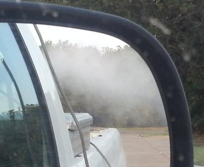 The rear view of a truck mounted with a mosquito fogger