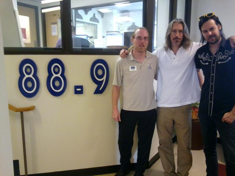 Left to Right: Matt Meinke, Craig Kinsey and Hank Schyma pause for a picture outside the KETR studios.