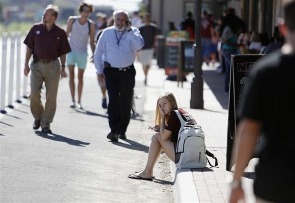 Student Amy Hoeks waits for the Texas A&M campus to reopen while authorities investigate a bomb threat Friday, Oct. 19, 2012.
