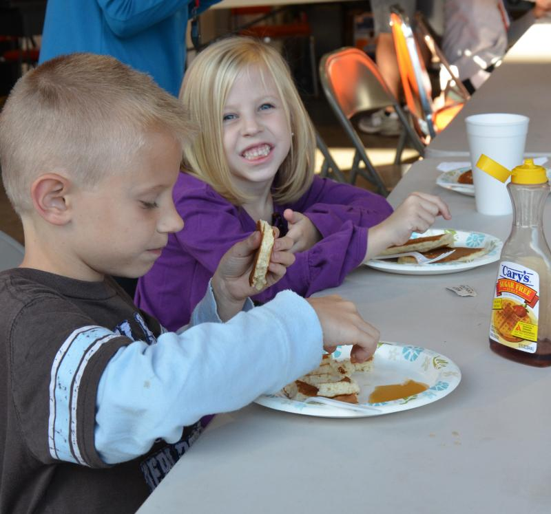 Children enjoy Lions Club Pancake Breakfast at Chiggerfest