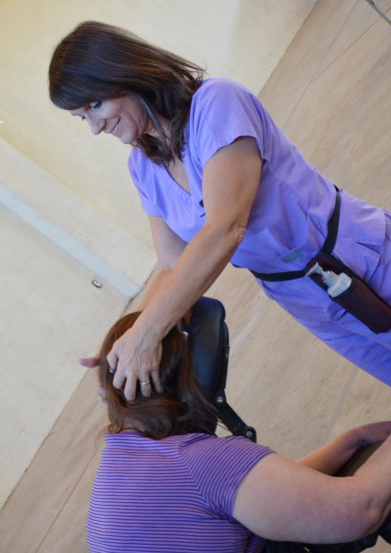 Massage For Heath therapist Renee McGraw puts her healing hands on a Chiggerfest Heath Fair goer.