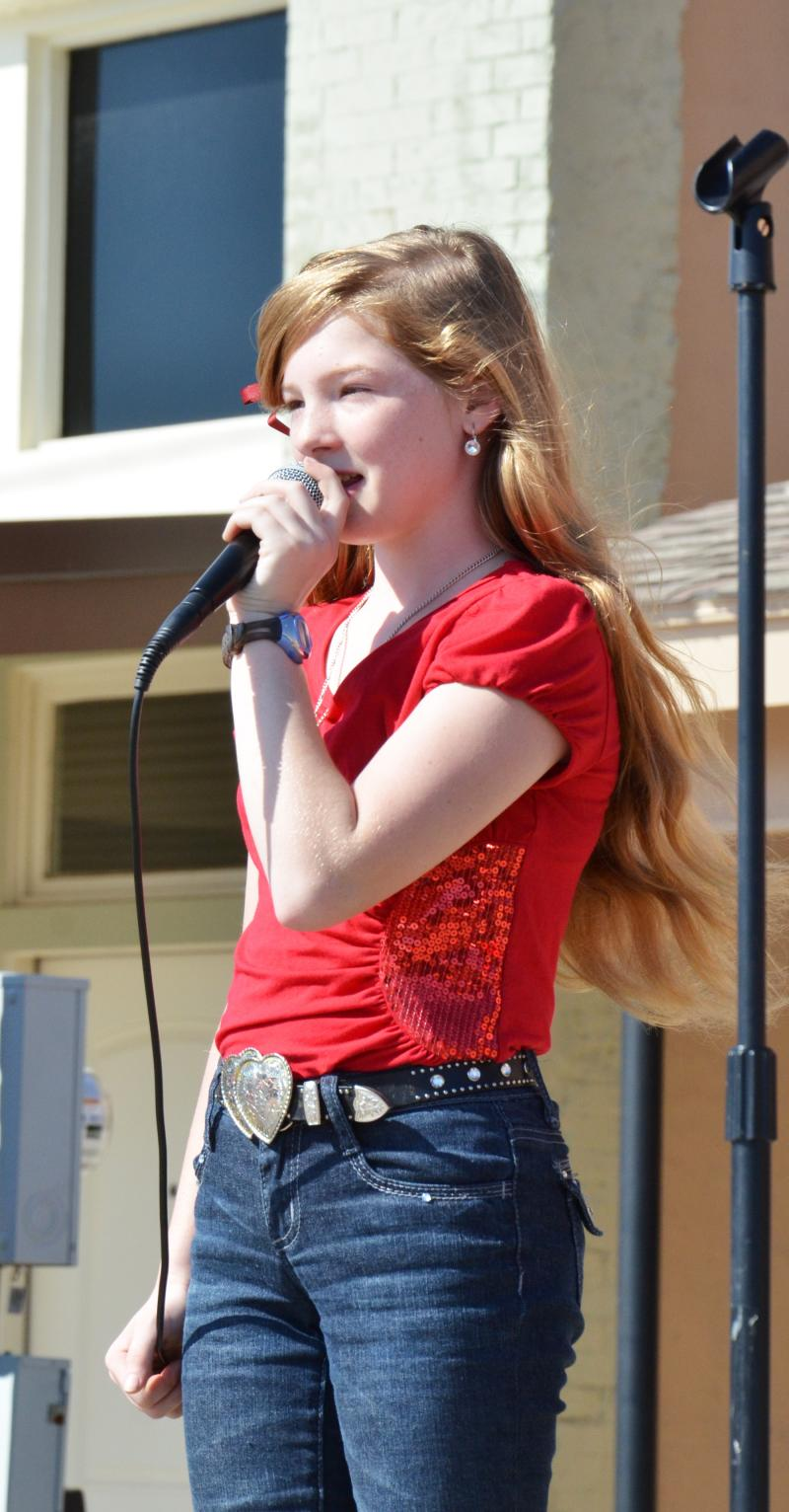 Hannah, 12-year old singer of Two Hearts Plus performs at Chiggerfest