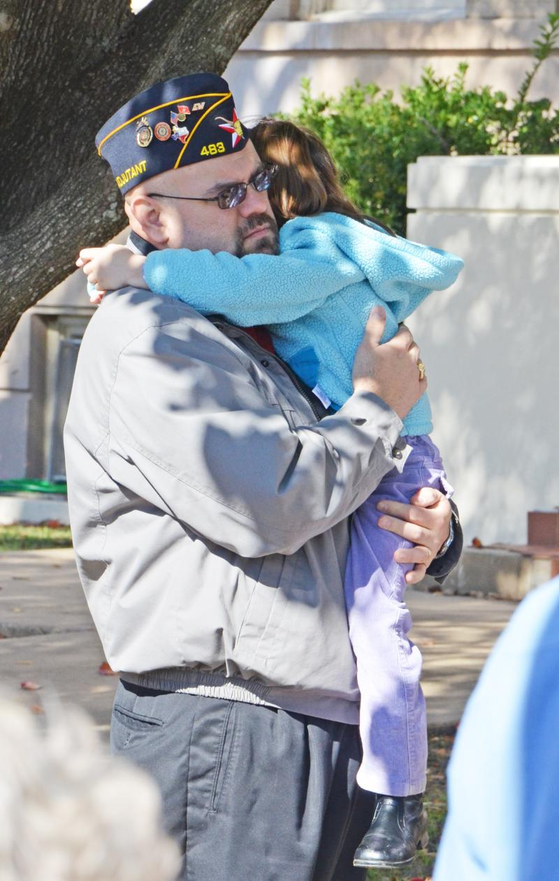 J.T. Sokol receives a hug following the Veterans program at the Delta County Courthouse.