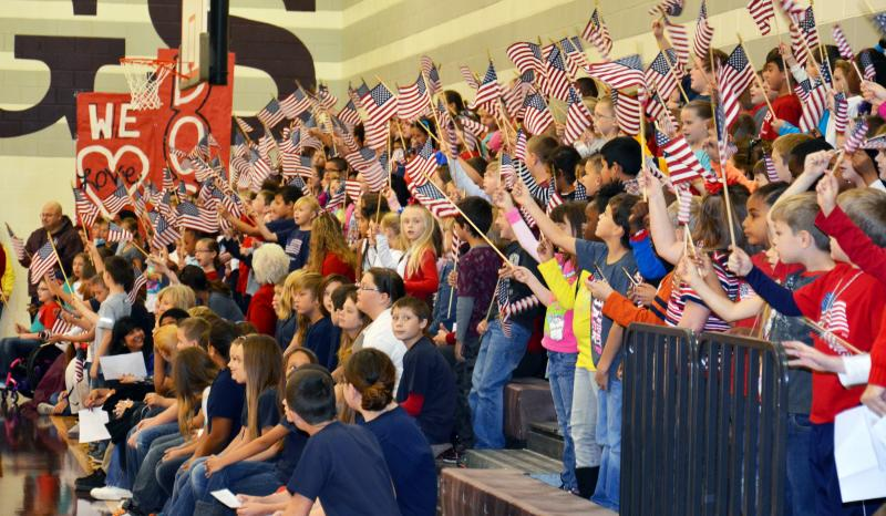 Cooper Elementary Students wave their American flags with pride.