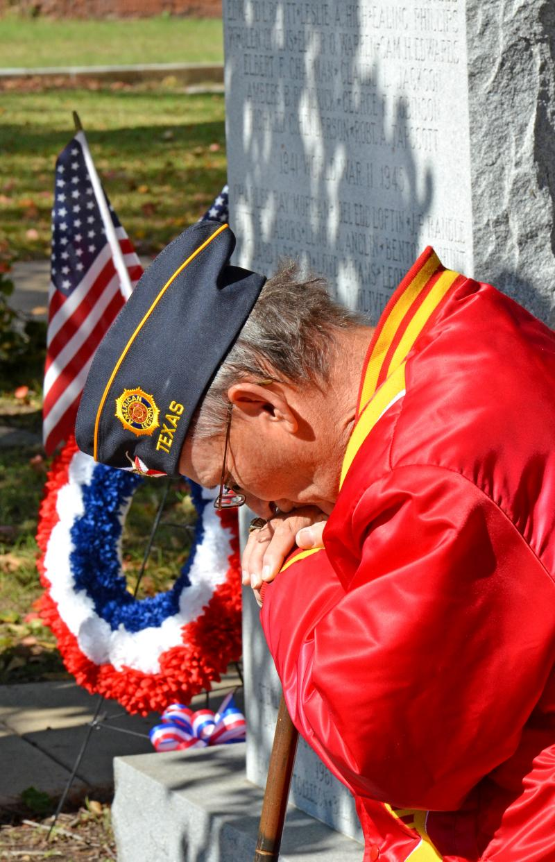 John Cleveland, Past Commander of Red Henderson Post 483, shows his respect for the fallen heroes.